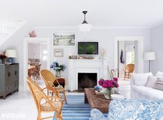 Gorgeous beach house living room with blue patterned armchair and rug