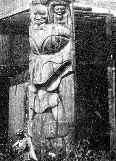 Detail of the base of the frontal pole showing a sea wolf eating a whale. Note the small figures in the ears and on the forehead of the sea wolf.