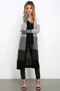 From Friday night to laid-back Sundays, it's always a good time when the Color Block Party Grey Striped Cardigan Sweater is around! Lightweight ivory knit fades to grey, then black, creating an ombre effect. Long fitted sleeves, an open front, and a midi-length hem complete this snuggle-worthy staple!