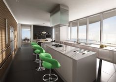 Lovely kitchen. I only don't like the green chairs...