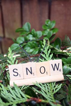 These would make great place card holders.  Instead of the Scrabble holders, you could glue them between 2 twigs and add some greenery!