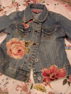 This is my daughters jean jacket and I sewed on vintage bark cloth flowers on the front and back. Stop by and say hello at my new blog. vintageflair.typepad.com/vintage_flair