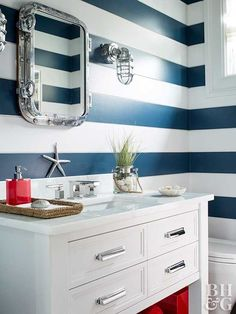 Red, white, and blue decor never looked so stylish! Decorate your home with stars, stripes, and patriotic colors to show off your American pride. These looks are perfect for summer holidays but can also last all year round. #redwhiteandbluedecor #homedecorideas #interiordesign #4thofjuly #bhg Nautical Bathrooms, Bathroom Red, Small Bathroom, Master Bathroom, Red Bathrooms, Bathroom Sinks, Costal Bathroom, Relaxing Bathroom, Silver Bathroom