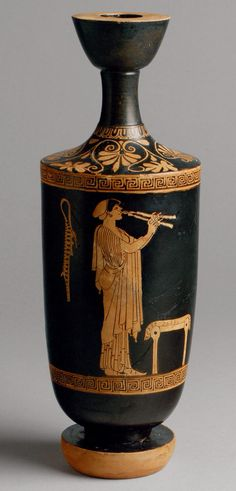 Terracotta lekythos (oil flask) A solitary figure decorates the elongated body of this small red-figure lekythos, a flask for oil and perfume distinguished by its narrow aperture. Although the single female figure may be considered an excerpt from a symposium scene, it is perfectly satisfactory in itself–partly because it is so masterfully composed. A young woman plays the aulos, a double-reed wind instrument. She wears an Ionic chiton, himation, shoes, a sakkos (scarf), disk earrings, and a…
