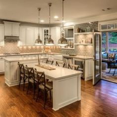 Traditional kitchen with large island table. #kitchen ...