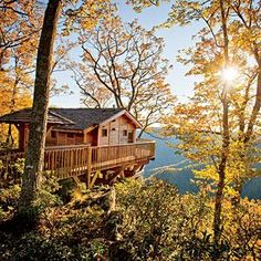 A deck, a hammock, a sunset view—what more do you need? We planned a luxury fall treehouse getaway for any budget. | SouthernLiving.com