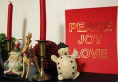"""Peace, Joy, Love"" Metallic Foil Print from Jenny Bevlin .. La Petite Fashionista http://lapetitefashionista.blogspot.com/2013/12/holly-jolly-sparkly-christmas-decor.html"