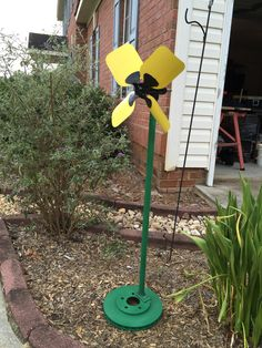Yard Ornament made from a brake rotor, a fan, aluminum tubing, and other miscellaneous stuff!