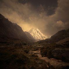 Glorious mountain through a darkened valley.