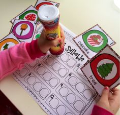 """Syllable Dab.. students select a picture and use a bingo dabber to dab the gumdrops to show the number of syllables. Common core aligned, includes """"I Can"""" poster to promote independent workers."""