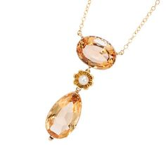 Antique Topaz Necklace, 14 k yellow gold with a 4.05 carat oval facet topaz, 6.75 pear shaped topaz and a pearl, circa 1820 with modern chain.