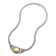 """#750131 s/s necklace w/18kt y/g accents & circle hammered disk design.  Necklace length is 18"""".  Contact us for more information @ http://carmouchejewelerslaplace.com/"""
