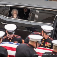 Annie Glenn watches from her funeral limo as the United States Marines carry the casket of Astronaut United States Senator and US Marine Colonel John Glenn and load him into the hearse before the funeral processional photographed Saturday December 17 2016 at the Ohio Statehouse. ( James D. DeCamp | http://JamesDeCamp.com | 614-367-6366) . . . . . . #johnglenn #614 #asseenincolumbus #JDeCampPhoto #columbusphotographer #cbus #columbusohio #godspeed #ohio #columbus #columbusohiophotographer