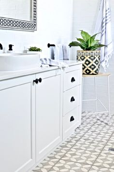 Modern Hamptons bathroom inspiration with gorgeous patterned floor tiles, a classic black and white palette and some graphic modern touches. Totally do-able Hamptons style for your contemporary or coastal home. Bathroom Styling, Bathroom Interior Design, White Bathroom, Small Bathroom, Bathroom Ideas, Black Bathrooms, Modern Bathroom, Budget Bathroom, Master Bathroom