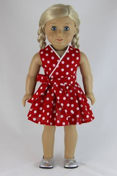 I love polka dot fabric! This red fabric with white dots works really well for this faux-wrap dress. Made by dollpetitecouture  on Etsy. Find the Frill Seekers Dress pattern at http://www.pixiefaire.com/products/frill-seekers-dress-18-doll-clothes.  #pixiefaire #frillseekers