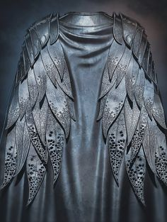 Vulturine's armor {Stunning! What exquisite detail on each of these leaf-feathers!}