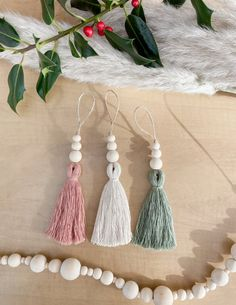 """Minimal Scandinavian/ modern boho style tassel Christmas ornaments with wooden bead accents. Great for Scandi style themes, modern boho, neutral, farmhouse, gift toppers, etc. Made with natural wooden beads and 100% cotton cord. You can choose the whole set of 3 or singles. If ordering a single ornament please put the colour in the personalization box (either natural, sage green, or dusty rose).They measure 6-7"""" from top to bottom.Shipped in 100% recyclable/ compostable shipping materials.Please Christmas Gift Decorations, Beaded Christmas Ornaments, Christmas Diy, Holiday Decor, Wood Bead Garland, Beaded Garland, Yarn Crafts, Bead Crafts, Decorative Beads"""