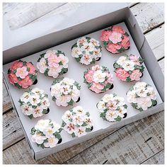 Twelve cherry blossom cupcakes