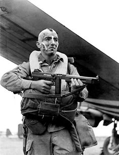 """Sgt Jake McNiece, Ponca City, Oklahoma, of the 101st Airborne Division, getting ready to drop into Normandy, June 1944. Jake was a member of the Choctaw nation, hence the """"Mohawk"""" style haircut.   Jake was a member of """"The Filthy Thirteen"""" which was the name given to the 1st Demolition Section of the Regimental Headquarters Company of the 506th Parachute Infantry Regiment, 101st Airborne Division, of the United States Army, which fought in the European campaign in World War II."""