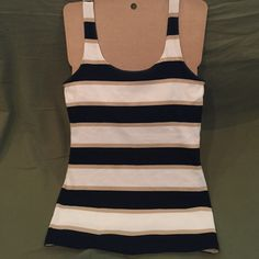 hello summer Banana Republic small tank. White, black, and tan formed fitted long  stripped tank in size small. 95% cotton and 5% spandex. Banana Republic Tops Tank Tops
