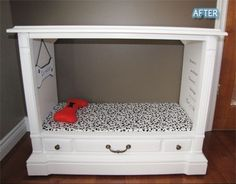 OLD TV entertainment center made into a dog bed... i was tryin to decide what to do with my old tv console that i bought to use as a faux fireplace til i got a fireplace... PERFECT idea... though the dog and cats will probably argue over whos bed it is... love it.. by Nubby Corner