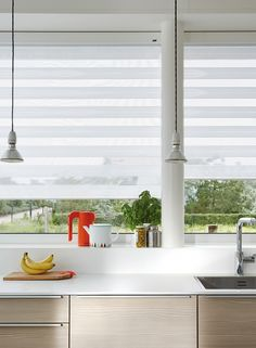 Luxaflex® Twist® Shades let just the right amount of light in. The perfect backdrop to a Scandinavian inspired kitchen with natural woods and gorgeous, glazed ceramics.