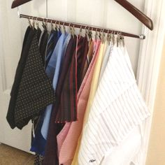 Pocket Square Rack - keeps my husbands pocket squares organized and wrinkle free using alligator clips and jewelry rings from the craft store attached to a wooden pants hanger.