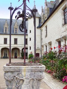 Gothic Wing and ancient well of Chaumont-sur-Loire