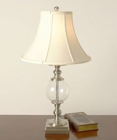 @Overstock - Add sophistication to any tabletop in your home with this metal-based glass ball lamp, which will look lovely with your contemporary decor. Its 16-inch shade is wider at the bottom, helping to provide ample light for reading and other tasks.     http://www.overstock.com/Home-Garden/Glass-Ball-Table-Lamp/2064081/product.html?CID=214117 $59.99