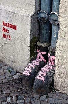 Street art. Pink laces in boring places