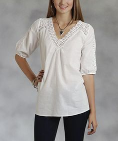 Loving this White Crochet-Trim V-Neck Top - Women on #zulily! #zulilyfinds I am thinking of this in another color. White and I don't get along very well!!!!