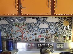Mosaic Backsplash    Mosaic Backsplash in my Kitchen. Tiles, beads, beans, mirror pieces, jewelry. I learned to do this from a book I checked out at the library.