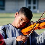 Omar Posada, 10, gives a violin a try at the musical petting zoo set up outside of the Victoria Fine Arts Center before Thursday's Symphonic Spooktacular. The petting zoo had brass instruments, string instruments and percussion instruments for children, and adults, to try out. Fine Arts Center, Petting Zoo, Photos Of The Week, Zoo Animals, Percussion, Violin, Musicals, The Outsiders, Instruments