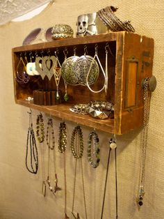 DIY - you could easily make this with a vintage drawer and some C-hooks;   Upcycled Jewelry Organizing Display