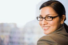 Businesswoman In Front Of Window Foto de stock 102915194   Thinkstock