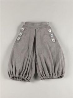 19th Century Cyclist Bloomers. Dating from 1895-1900. Made from mottled grey wool twill, and mother of pearl buttons. Became a staple when the recreational sport of cycling (bicycling) became all the rage. Found at the Palais Galliera.