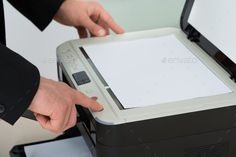 Buy Businessman's Finger Pressing Button Of Photocopy Machine by AndreyPopov on PhotoDune. Cropped image of businessman's finger pressing button of photocopy machine in office Wireless Printer, Crop Image, Finger, Buttons, Stock Photos, Fingers, Plugs