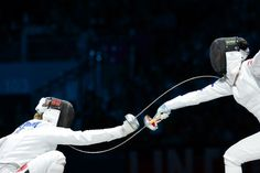 South Korea's Shin A Lam (R) fences against Germany's Britta Heidemann at the London 2012 Olympic games.