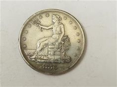 US 1876 S Silver Trade Dollar Coin  Featured in the US Coins Auction on July 25, 2013 HamptonAuction.com