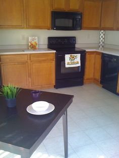Staging makes a big difference when selling your home! Borrowed folding table, a garage sale and Ikea, total cost $14!
