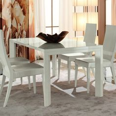 Image from http://lvluxhome.com/wp-content/uploads/2014/03/dining-room-cool-dining-room-design-ideas-with-rectangular-white-extendable-dining-table-yet-white-wood-dining-chair-and-white-crocodile-leather-chair-pad-stunning-extendable-dining-table-for-dining-r.jpg.