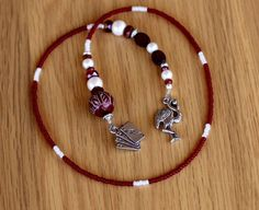 The  deep reds and pale creams are a perfect combo and make marking your place in your book a total pleasure.  Don't use a piece of paper, use this gorgeous and sumptuous bookmark. #beads, #AliceinWonderland #red #pearl #bookmark #glass #beaded #luxury #book