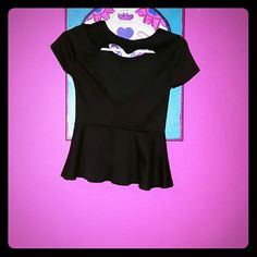 Heart cutout peplum top Cute peplum top. Back has a heart cutout. Never worn. Forever 21 Tops Blouses