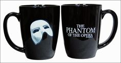 Black ceramic coffee mug with the Phantom of the Opera title logo on one side. The other side is plain black when the mug is cold - but fill it with a hot beverage and watch the Phantom's mask appear like magic!