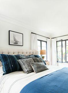 White walls, wood floors, light curtains, índigo pillows, white and indigo blue bed linens - Studio McGee
