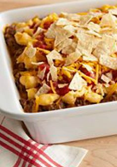 VELVEETA Nacho Bake – This VELVEETA Nacho Bake recipe is hearty with salsa, sour cream and ground beef—all covered with a topping of cheesy crushed tortilla chips.