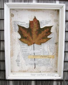 four corners design: its all in the details...old beat up white painted frame , a piece of cardboard with white paint and a portion of an old dictionary page glued on and then partially torn off, one large maple leaf attached with linen bookbinding tape, and a quote typed on an old typewriter...