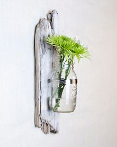 driftwood wall sconce....I'd use copper or leather strips to hold nice jars or small vases....votive candles maybe?