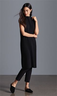 Women's fashion | Minimal black dress over jeans with flats