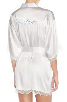 This silky-soft satin robe features romantic lace trim and 'The Bride' embroidered across the back in scrolling cursive. It's the perfect bridal shower gift!